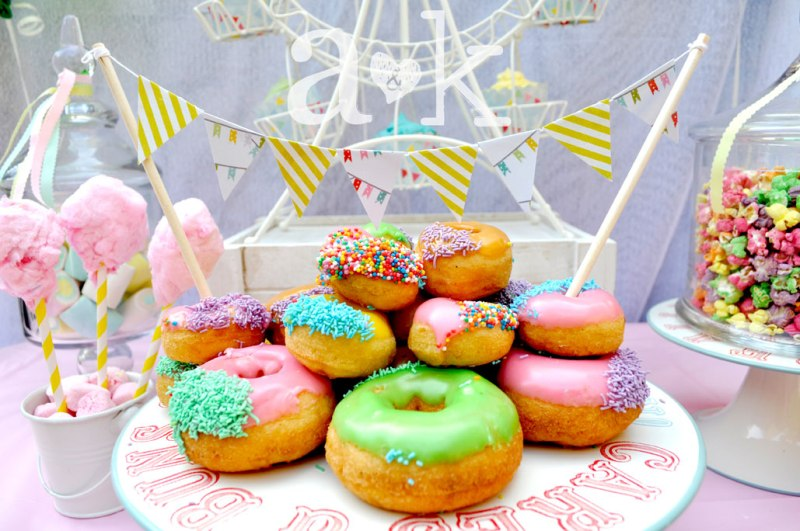 Pastel Carnival Party by A&K Lolly Buffet | Colourful iced donuts on Jaimie Oliver Tin Cake Stand