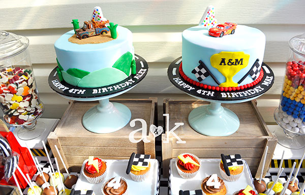 Cars themed cake on mint green Robert Gordon cake stand