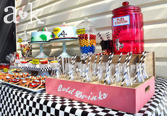 Drinking station with red glass jar, milk bottles, and vintage wooden tray
